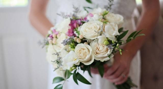 Wedding Flowers include bridal bouquets, bridesmaids bouquets, boutonnieres, corsages and flowers set up throughout.